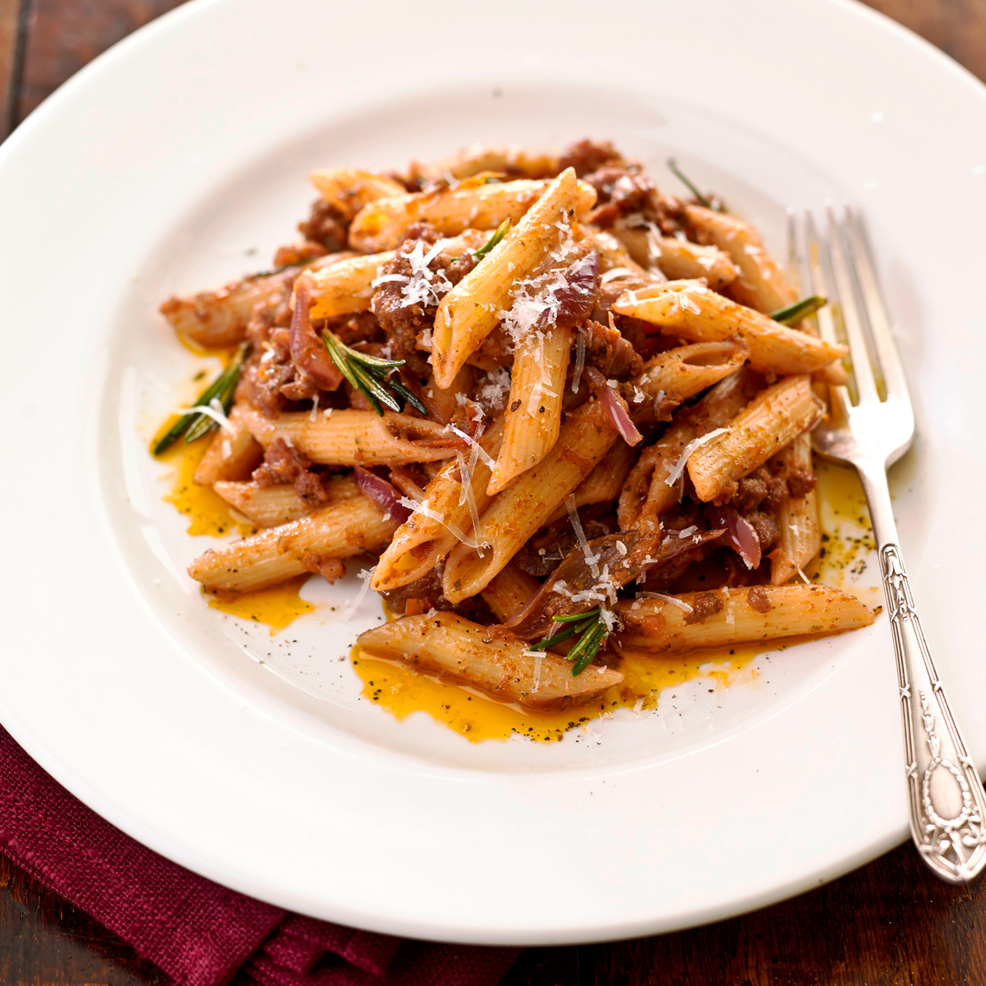 Penne with Spicy Sausage And Rosemary Ragù | Filippo Berio
